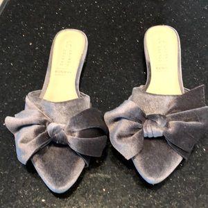 Gray velvet bow mules.